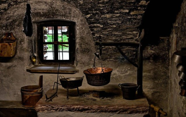 Ancient kitchen with a witch cauldron